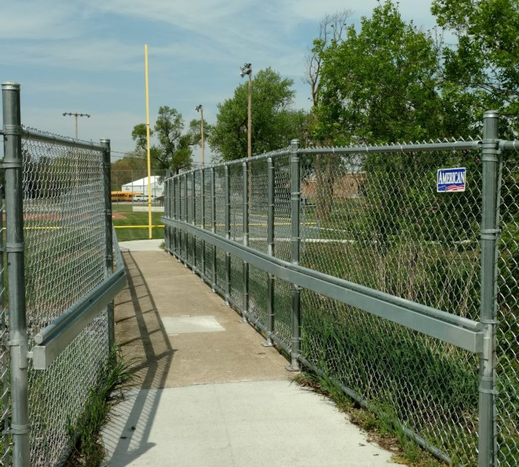 Hand rail and chain link fence made custom to ensure safety and security