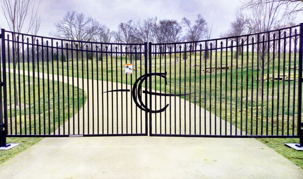 Custom double swing automated gate with C emblem