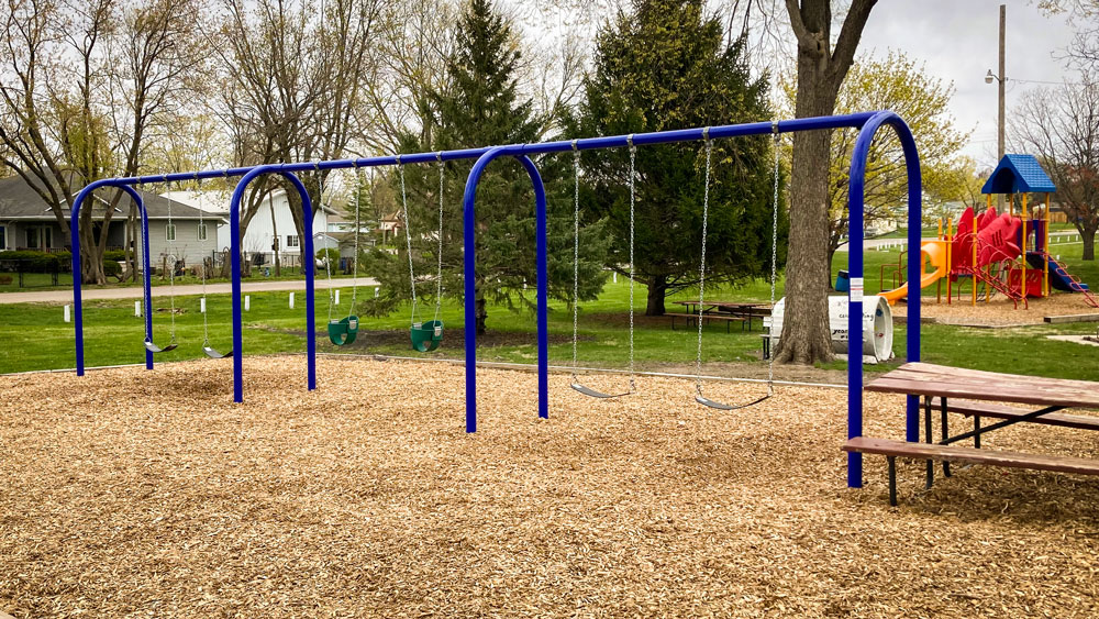 Swing set with blue metal frame for small residential park. Playground company Grand Island, Nebraska playground installation playground equipment slides swings surfacing climbers children recreation safety durable
